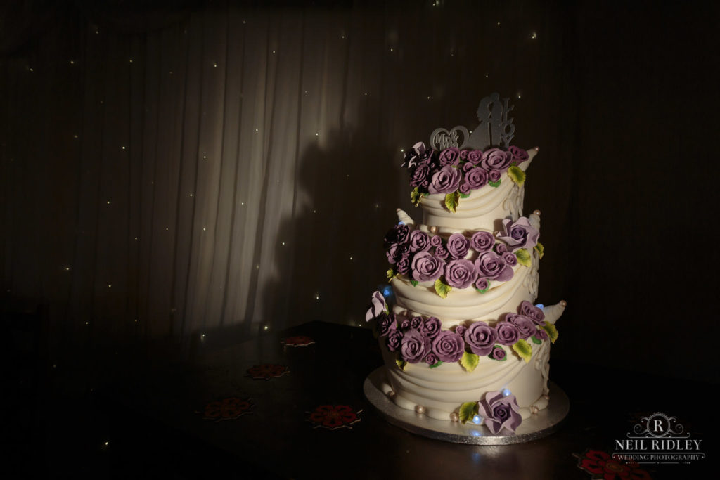 Lancaster Wedding Photographer - Three tier Wedding Cake wth Purple Flowers at Lancaster Brewery