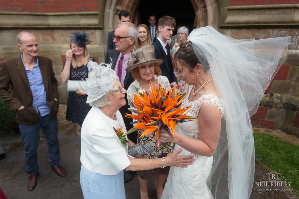 Bride with relatives outside St Thomas Church in St Annes-on-Sea
