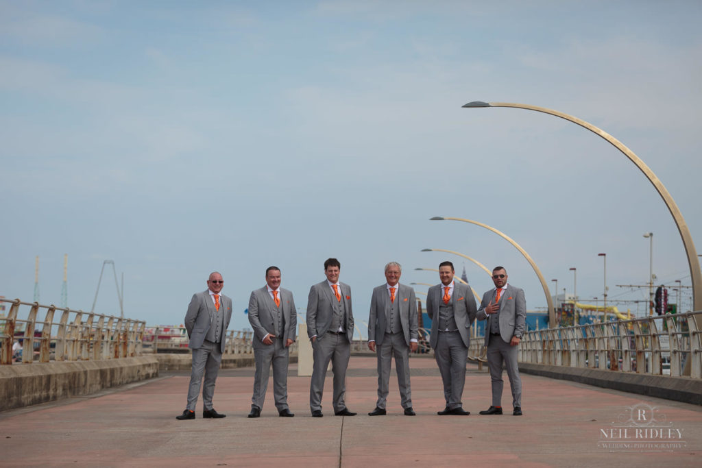 Groom and his groomsmen on the promenade in Blackpool