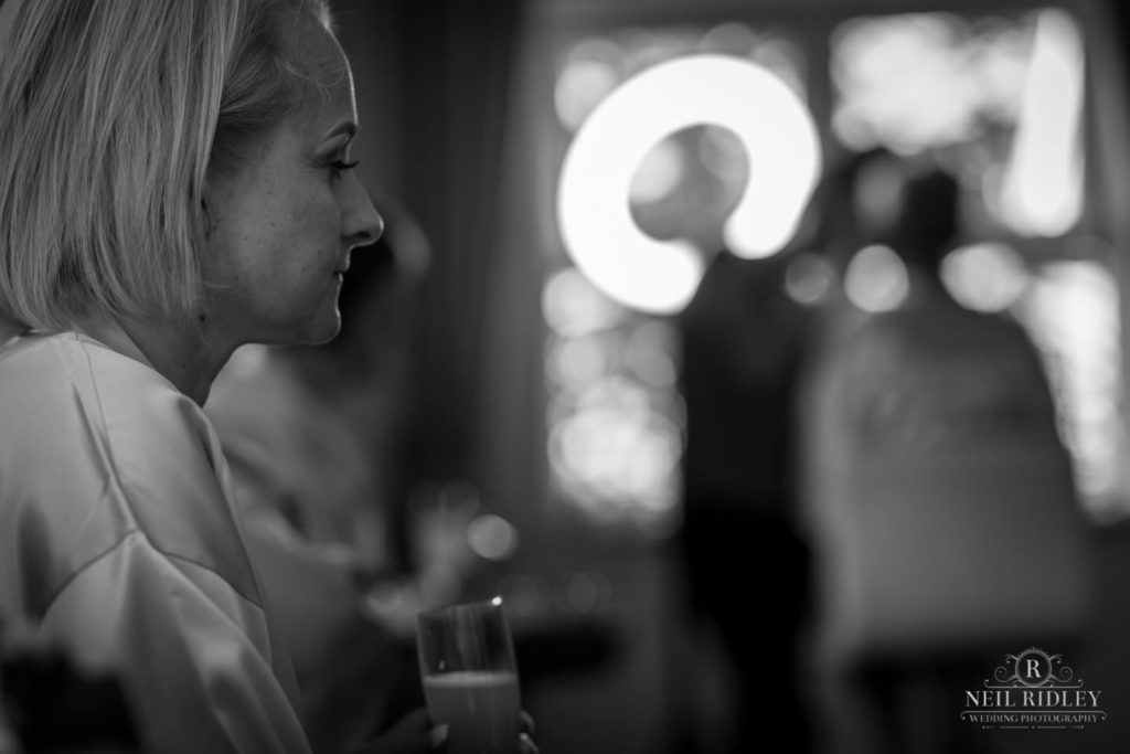 Black and white image of Bride during bridal Prep