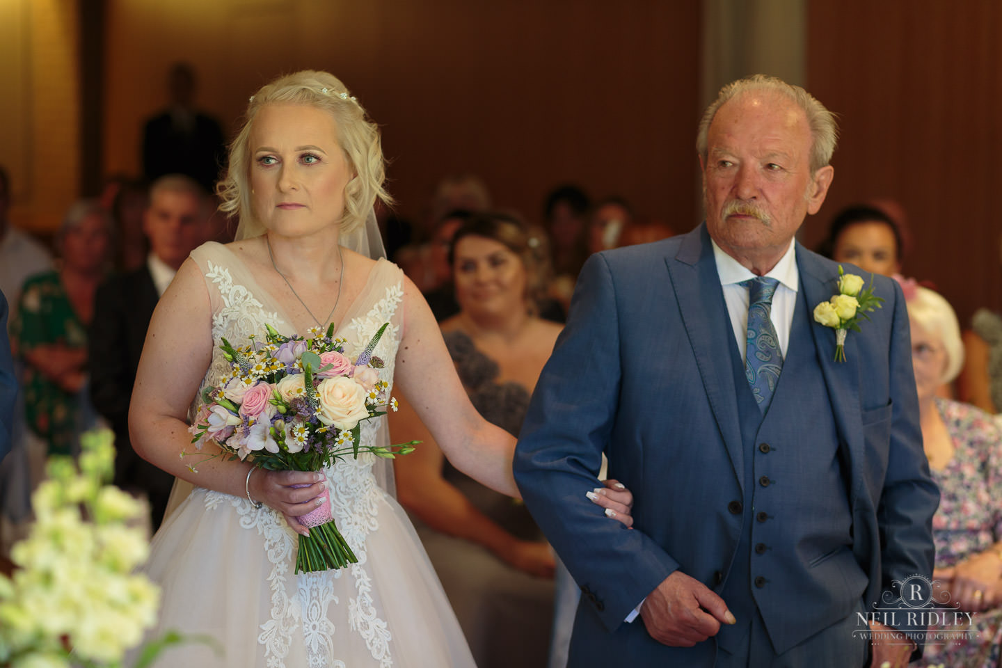 Bride and her father walking down the aisle at Macdonald Portal Hotel, Tarporley