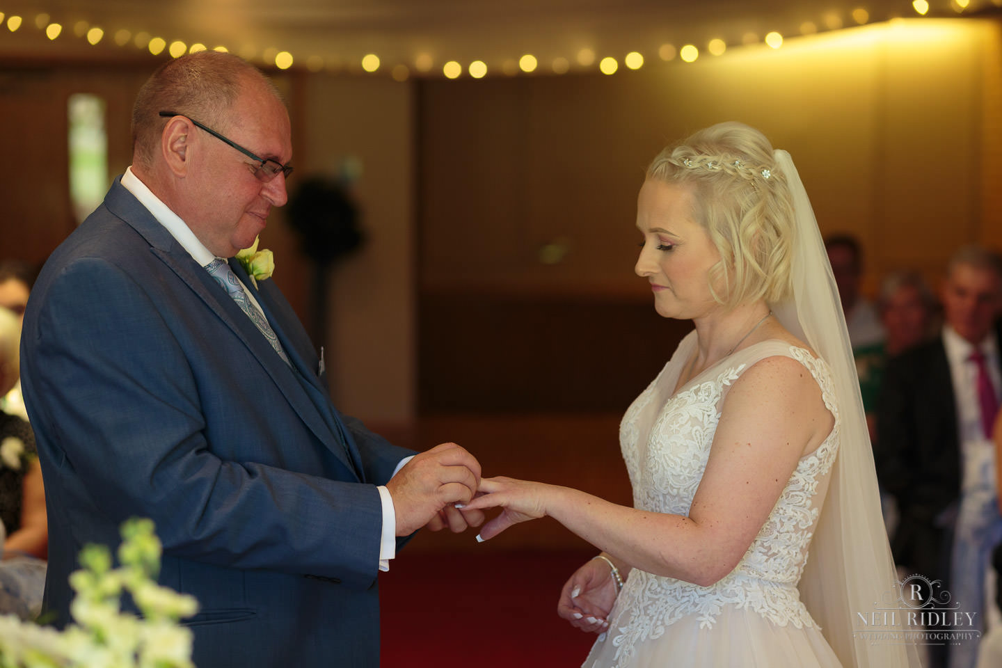 Bride and Groom exchange wedding rings at Macdonald Portal Hotel, Tarporley
