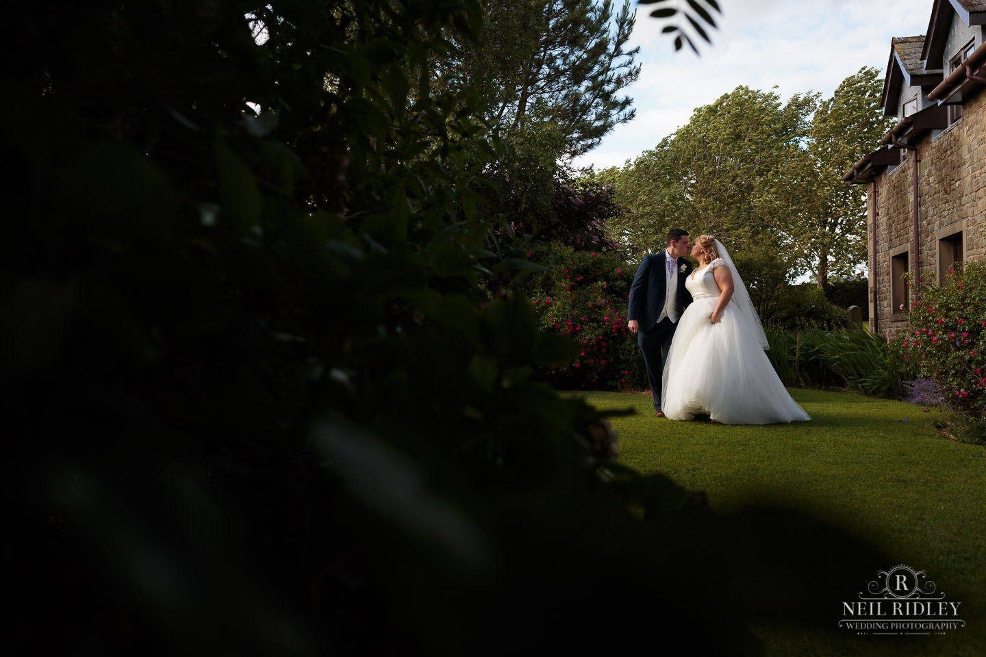 Bride and Groom in the grounds of Garstang Country Hotel and Golf Club