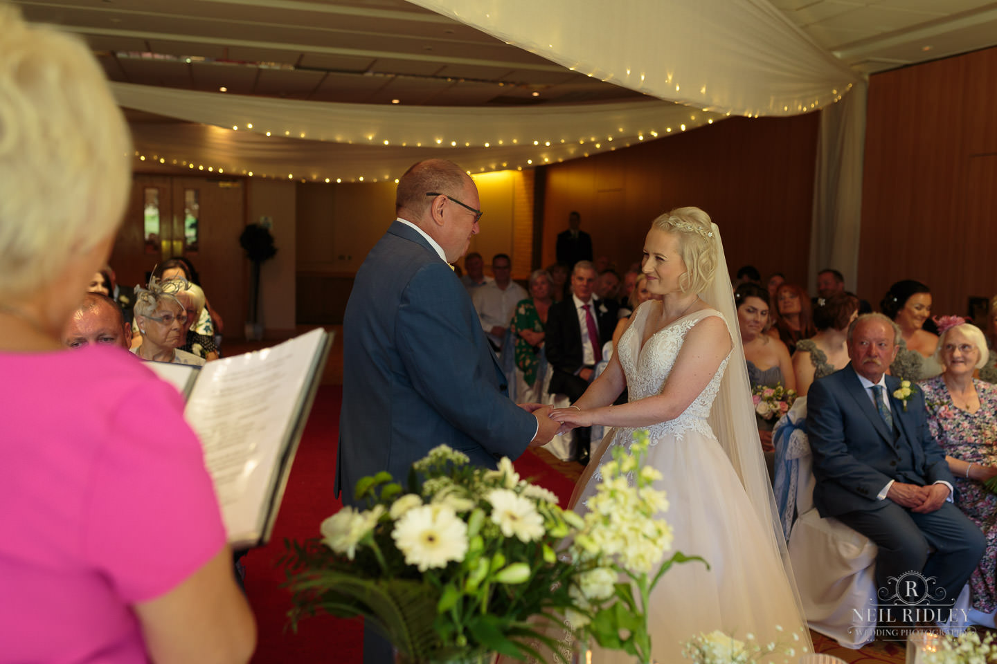 Bride and groom exchange wedding vows at Macdonald Portal Hotel, Tarporley