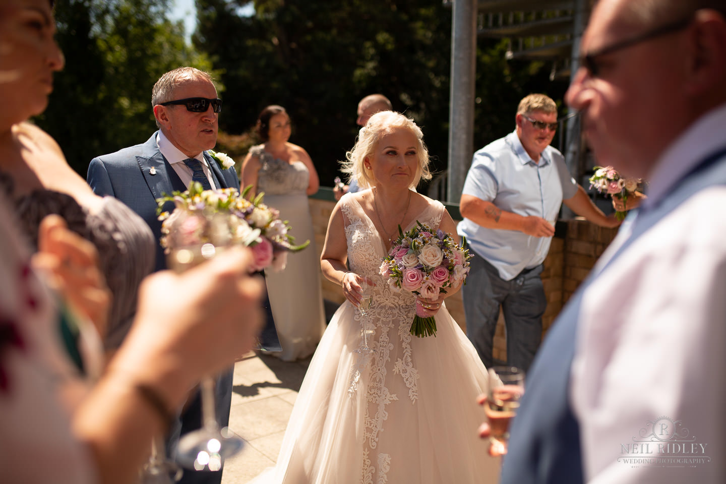 Bride outside holding her bouquet at Macdonald Portal Hotel, Tarporley