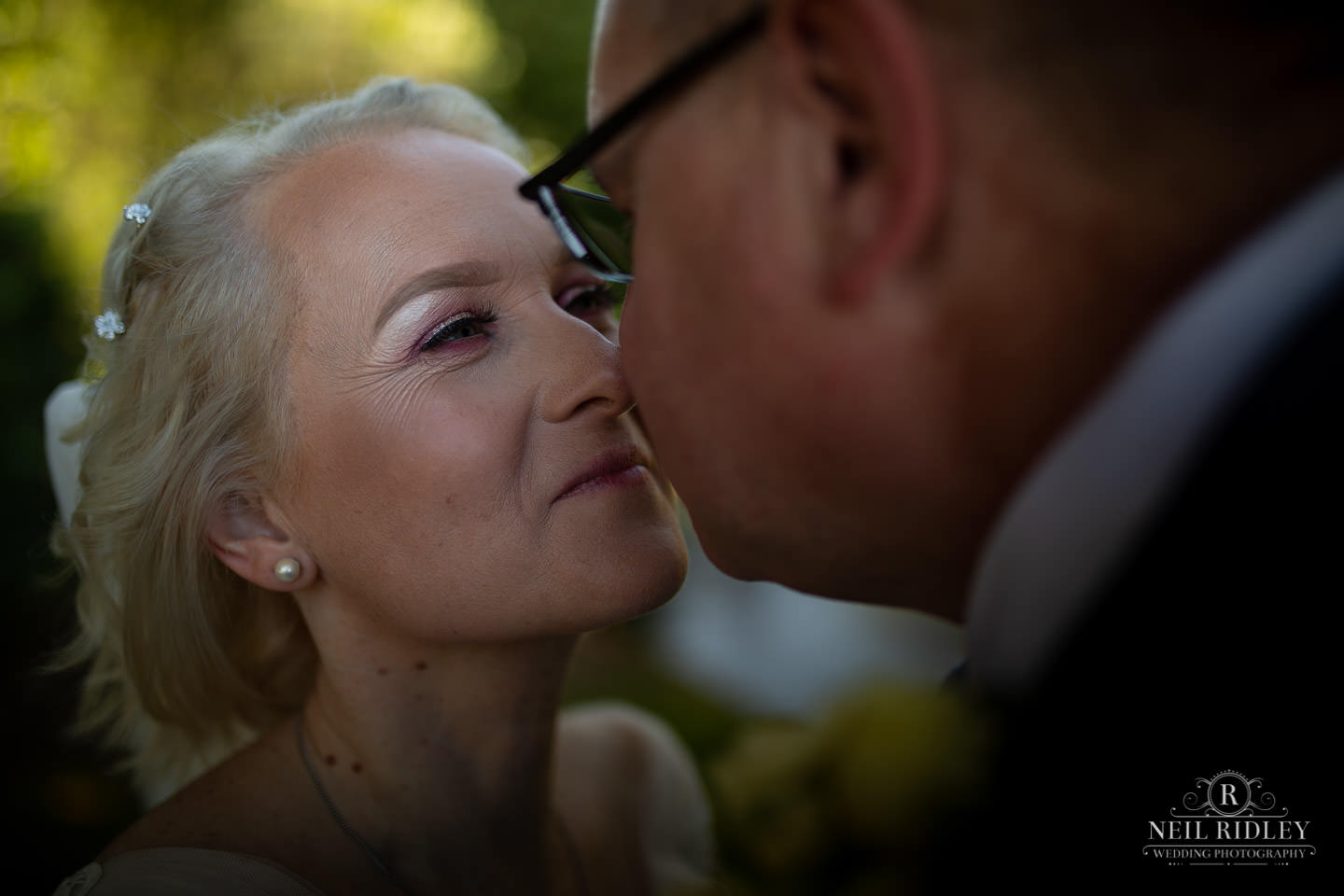 Bride and groom close up at Maccdonald Portal Spa and Hotel