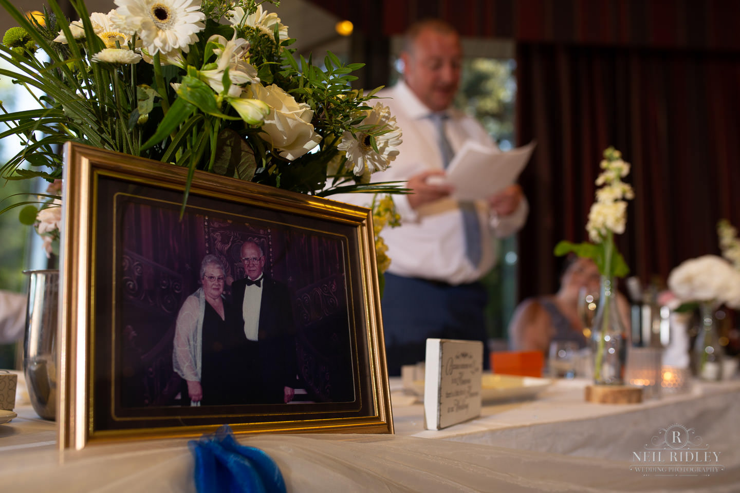 Photo of grooms mother and father at the top table at Maccdonald Portal Spa and Hotel
