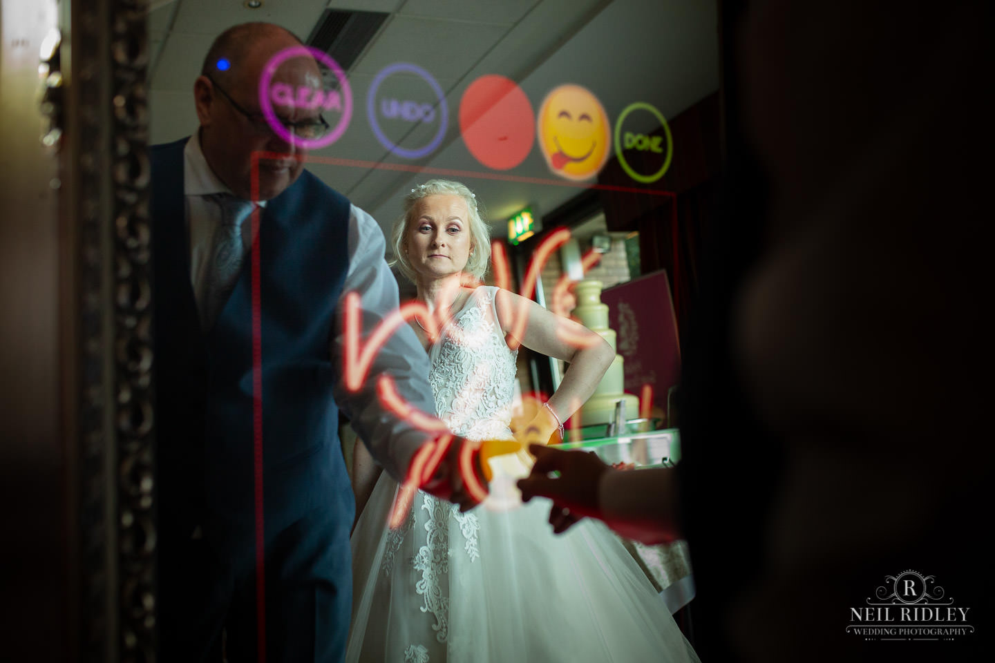 Groom writes love you on magic mirror at Maccdonald Portal Spa and Hotel