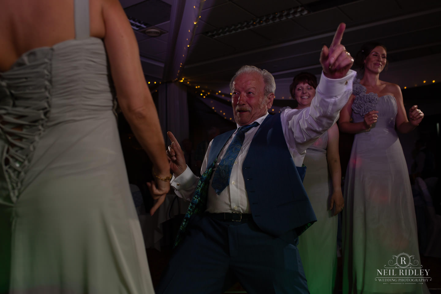 Father of the bride dances on the dancefloor at Macdonald Portal Hotel, Tarporley