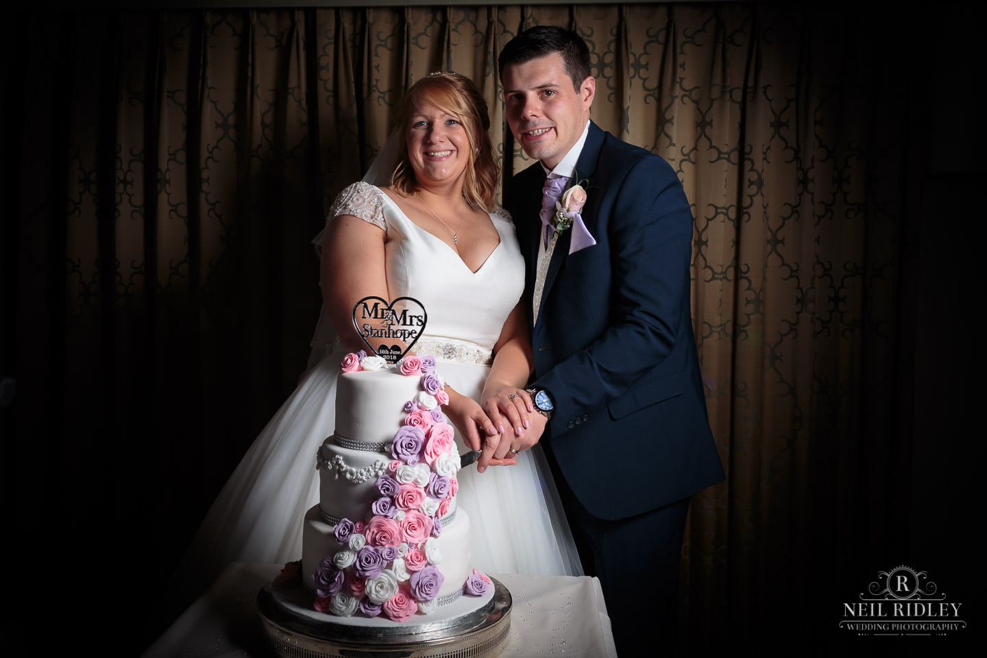 Bride and Groom cut the cake at Garstang Country Hotel and Golf Club