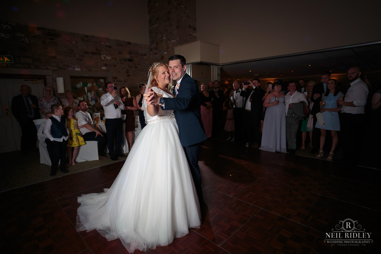 Bride and Groom enjoy first dance on the dance floor at Garstang Country Hotel and Golf club