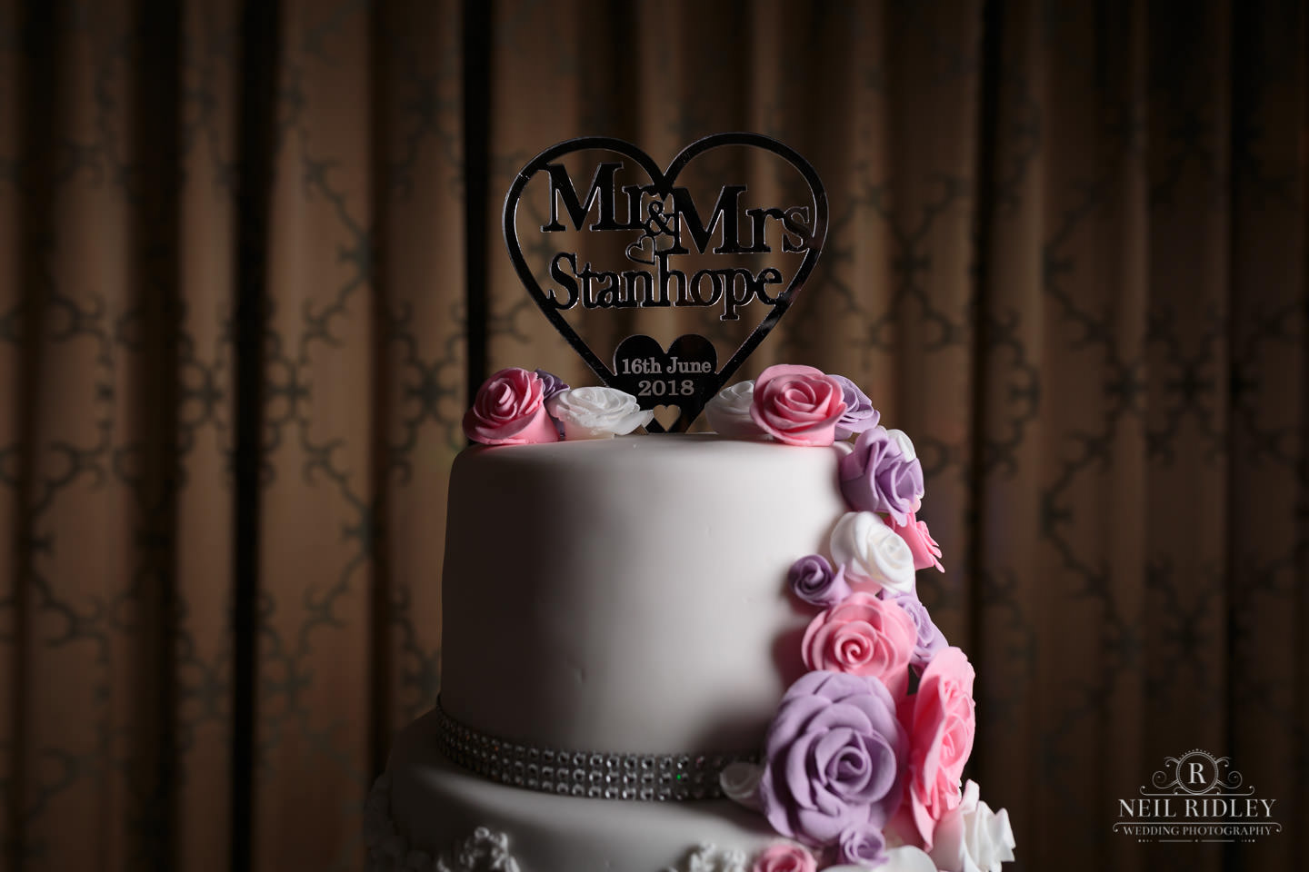 Wedding Cake with cake topper at Garstang Country Hotel and Golf club