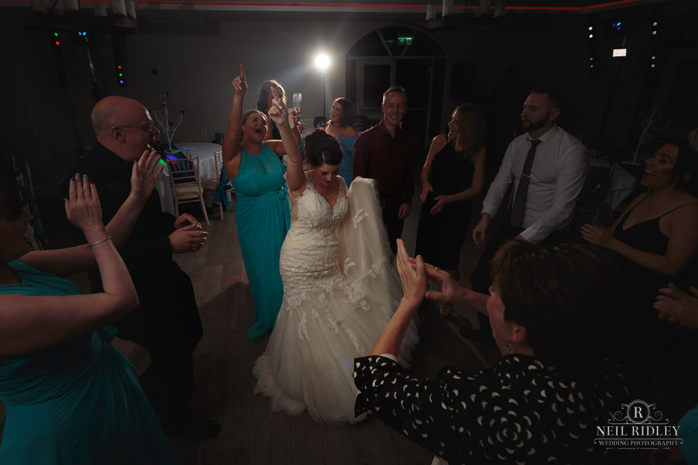 Bride dances on the dancefloor at The Mill at Conder Green