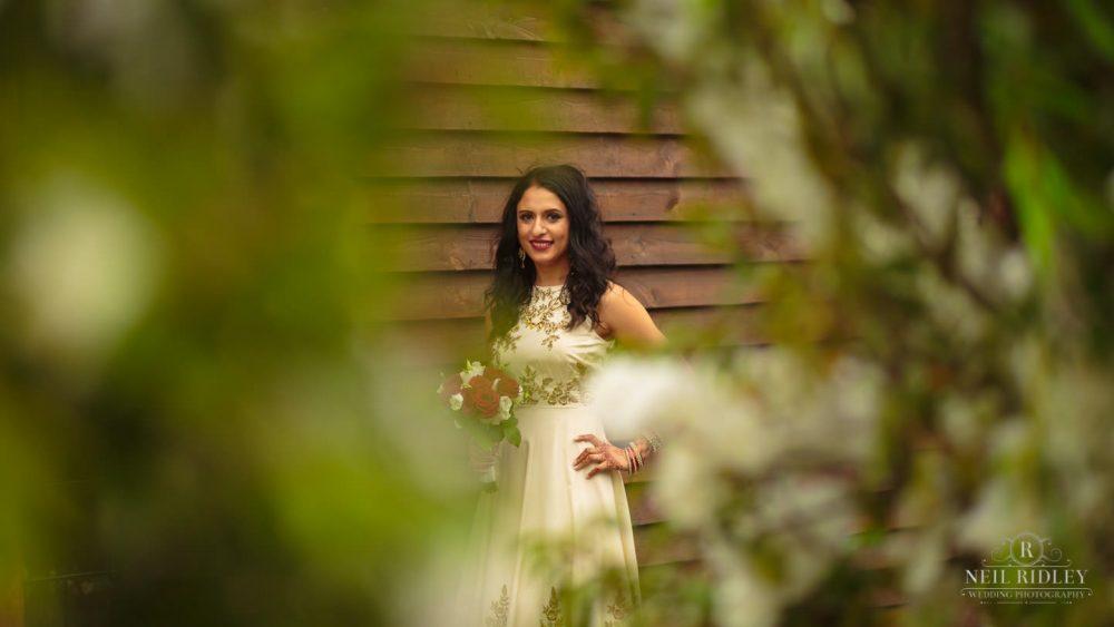 Merrydale Manor Wedding Photographer - Bride posing with bouquet