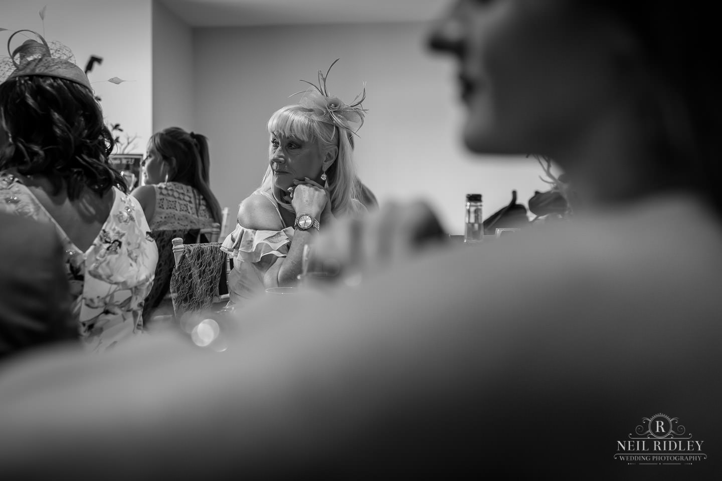 Black and white image of wedding guests at The Mill at Conder Green