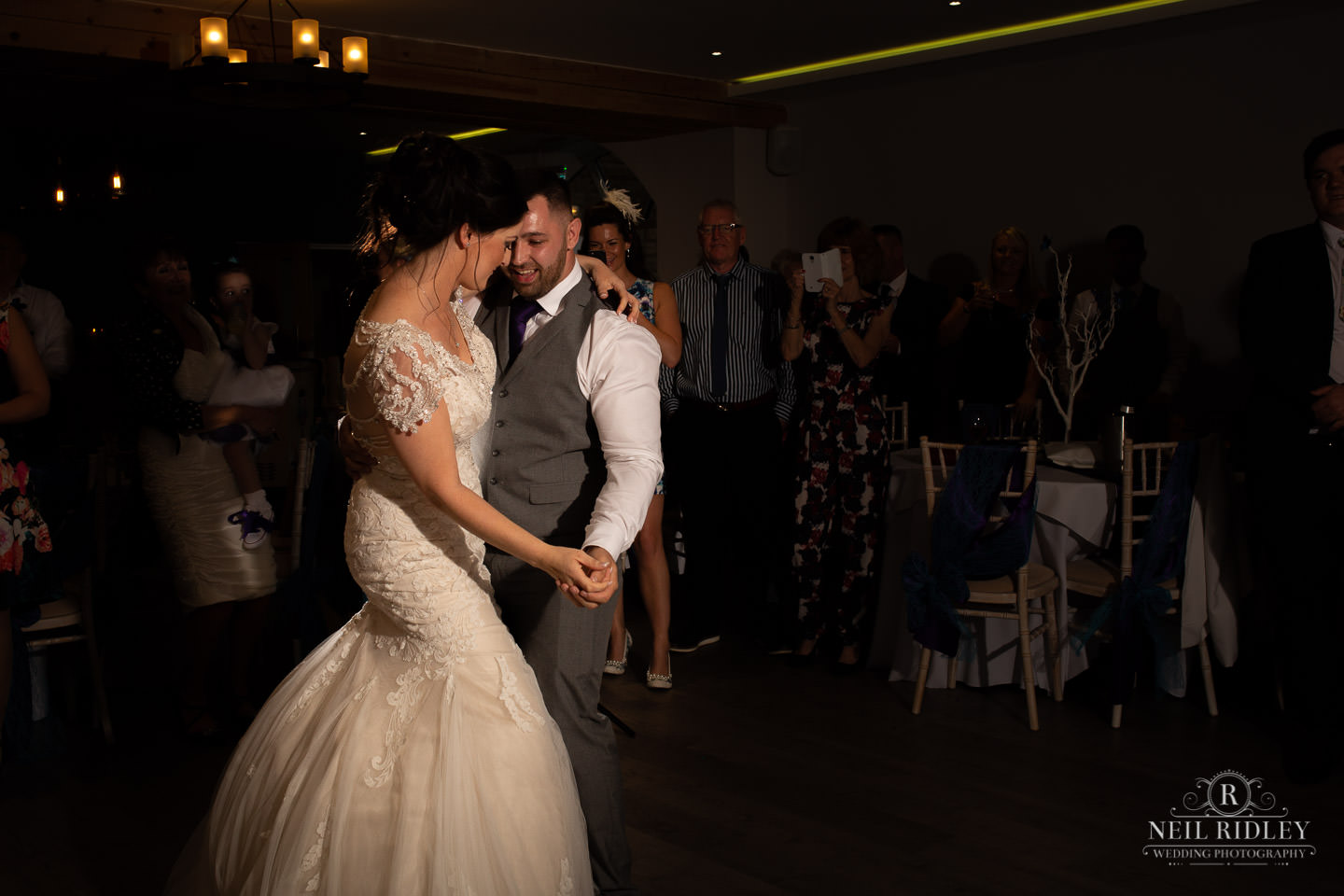 Bride and Groom have their first dance on the dance floor at The Mill at Conder Green