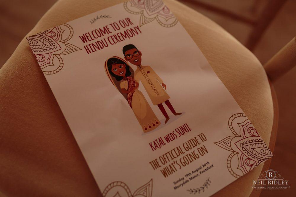 Merrydale Manor Wedding Photographer - Hindu Wedding Guide on a chair