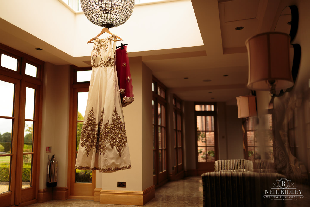 Merrydale Manor Wedding Photographer - Wedding Dress hangs from a light fitting