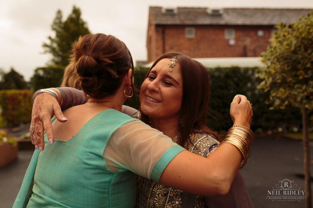 Merrydale Manor Wedding Photographer - Wedding guests embrace