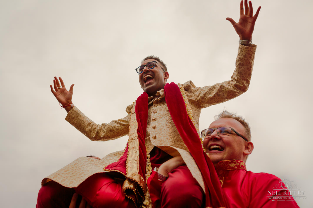 Merrydale Manor Wedding Photographer - Groom being carried on shoulders