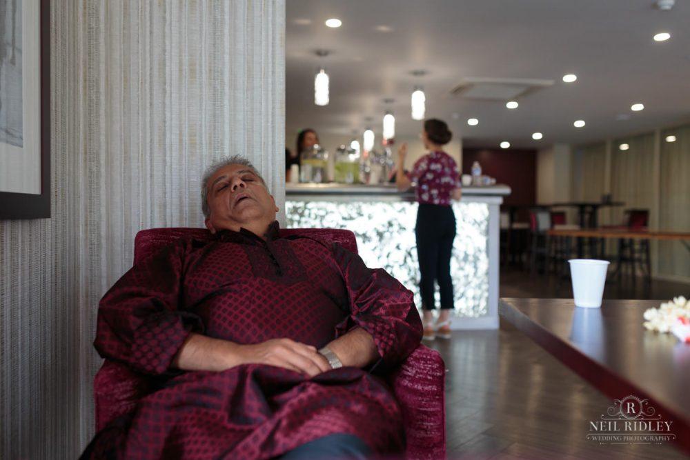 Merrydale Manor Wedding Photographer - Guest asleep in the bar