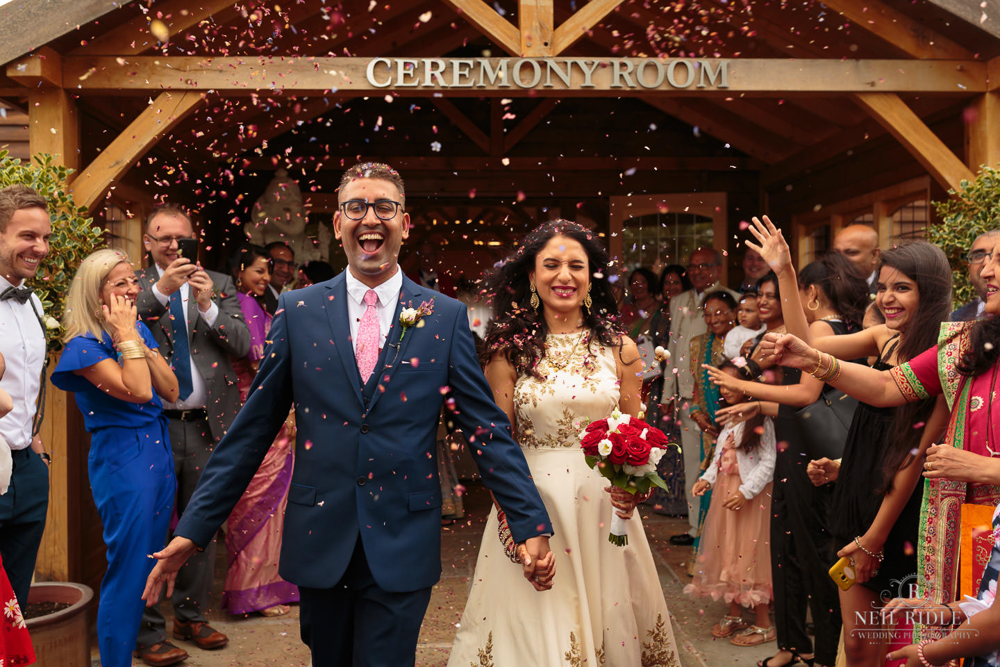 Merrydale Manor Wedding Photographer - Bride and Groom confetti throw