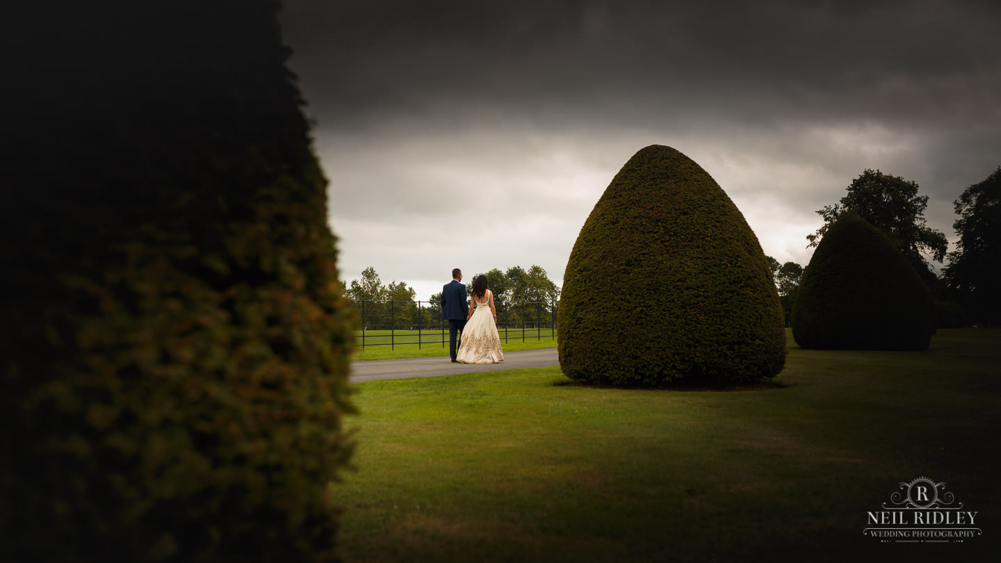 Merrydale Manor Wedding Photographer - Bride and Groom walking in the grounds