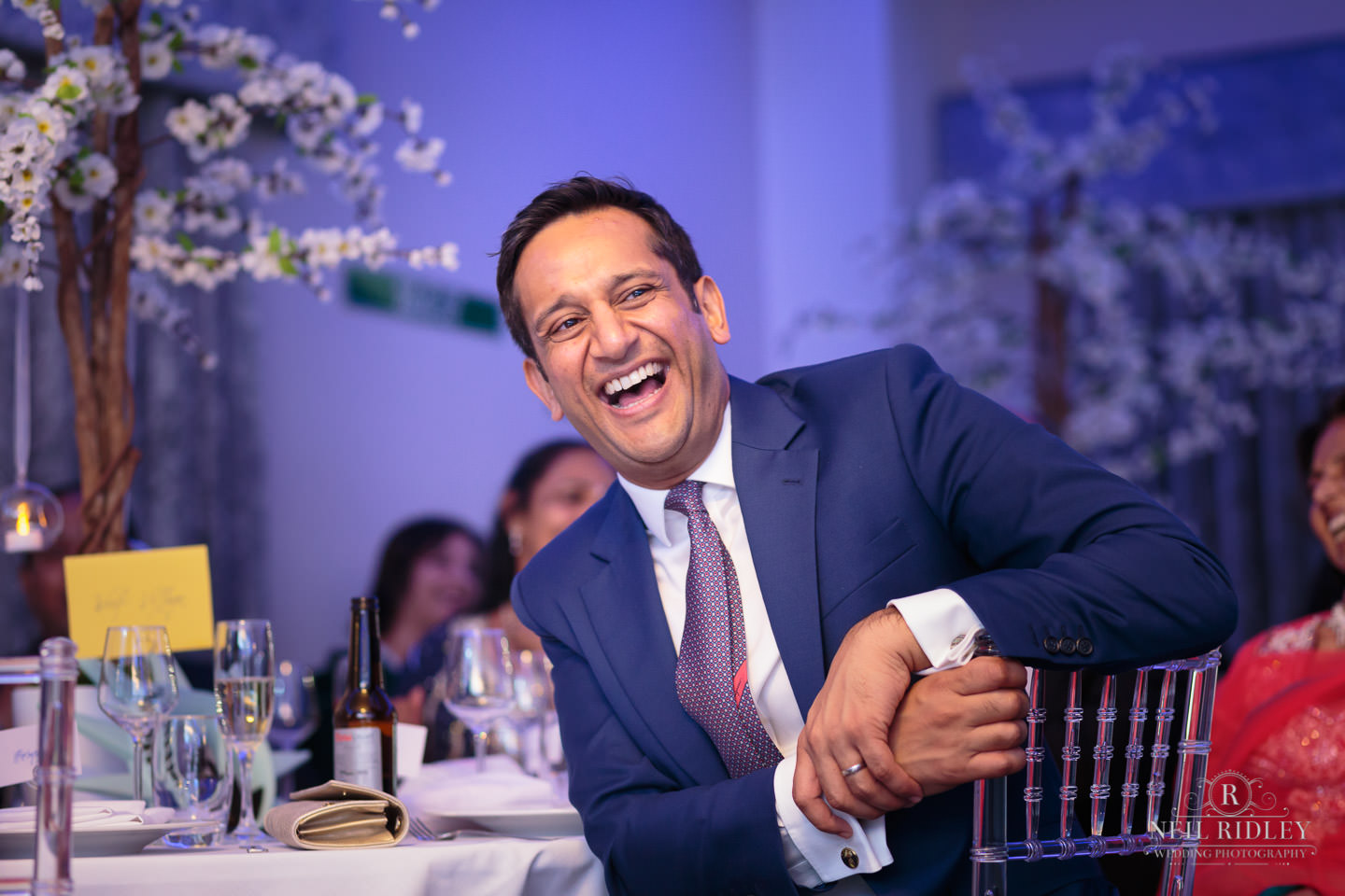 Merrydale Manor Wedding Photographer - Wedding guest laughs during the speeches