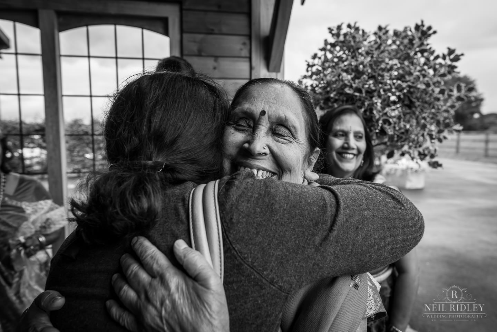 Merrydale Manor Wedding Photographer - Hindu wedding guests embrace