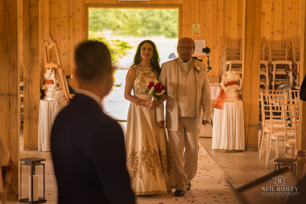 Merrydale Manor Wedding Photographer - Bride walking down the aisle