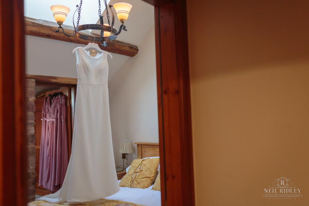 Beeston Manor Wedding Photographer Hanging Wedding Dress
