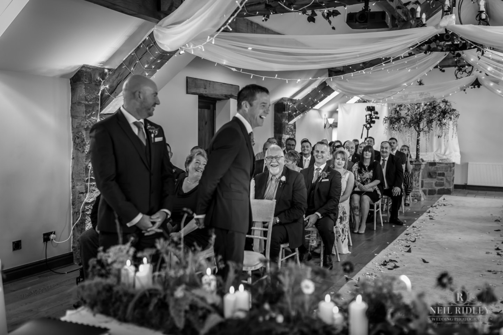Beeston Manor Wedding Photographer - Wedding Party Laughing